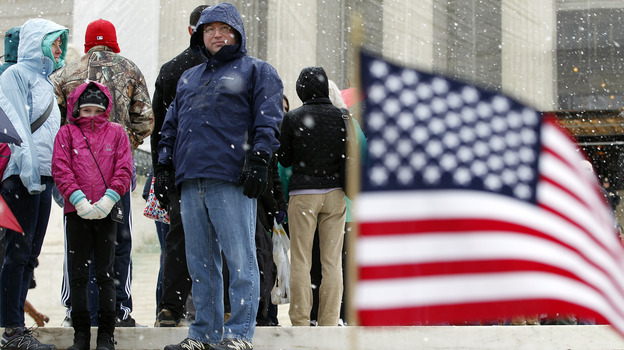 A scene outside the Supreme Court on Monday, as the justices announced they would hear another case involving affirmative action in higher education. Many of those waiting in line at the court in a late-season snowfall were hoping to attend oral arguments on gay-marriage cases being heard Tuesday and Wednesday. (AP)