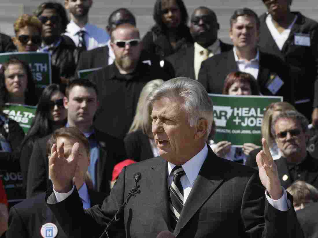 Arkansas Gov. Mike Beebe speaks at a rally promoting the expansion of Medicaid in the state in front of the Capitol in Little Ro