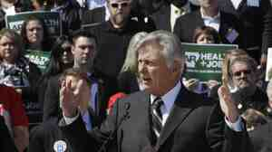 Arkansas Gov. Mike Beebe speaks at a rally promoting the expansion of Medicaid in the stat