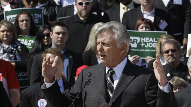 Arkansas Gov. Mike Beebe speaks at a rally promoting the expansion of Medicaid in the state in front of the Capitol in Little Rock on March 7. (AP)
