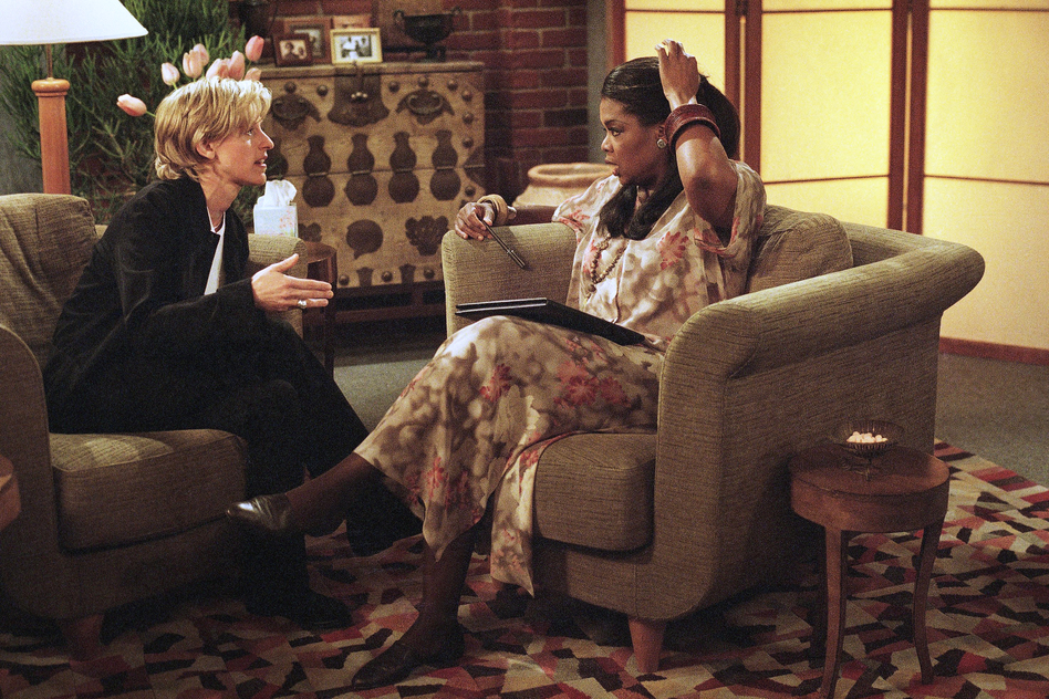 DeGeneres, playing the character Ellen Morgan, discussing her fears about coming out as a lesbian with her therapist, played by Oprah Winfrey, during the taping of the Ellen show in 1997. (AP)