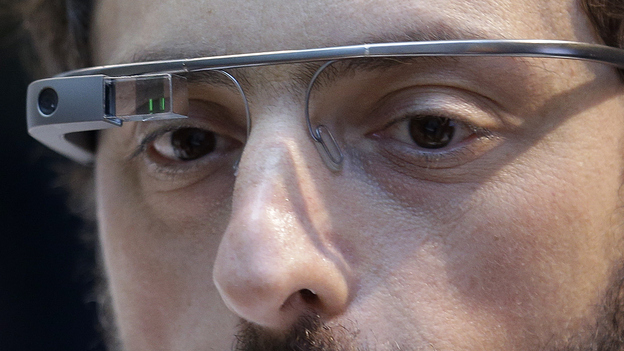 Google co-founder Sergey Brin wears Google Glass glasses at an event on the University of California, San Francisco's Mission Bay campus on Feb. 20. (AP)