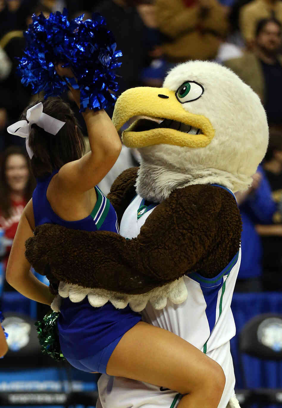 The Florida Gulf Coast Eagles mascot picks up an Eagles cheerleader after the team's 81-71 victory agai
