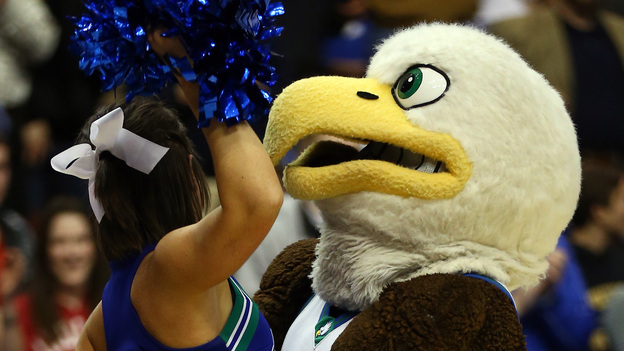 The Florida Gulf Coast Eagles mascot picks up an Eagles cheerleader after the team's 81-71 victory against the San Diego State Aztecs on Sunday in Philadelphia. (Getty Images)