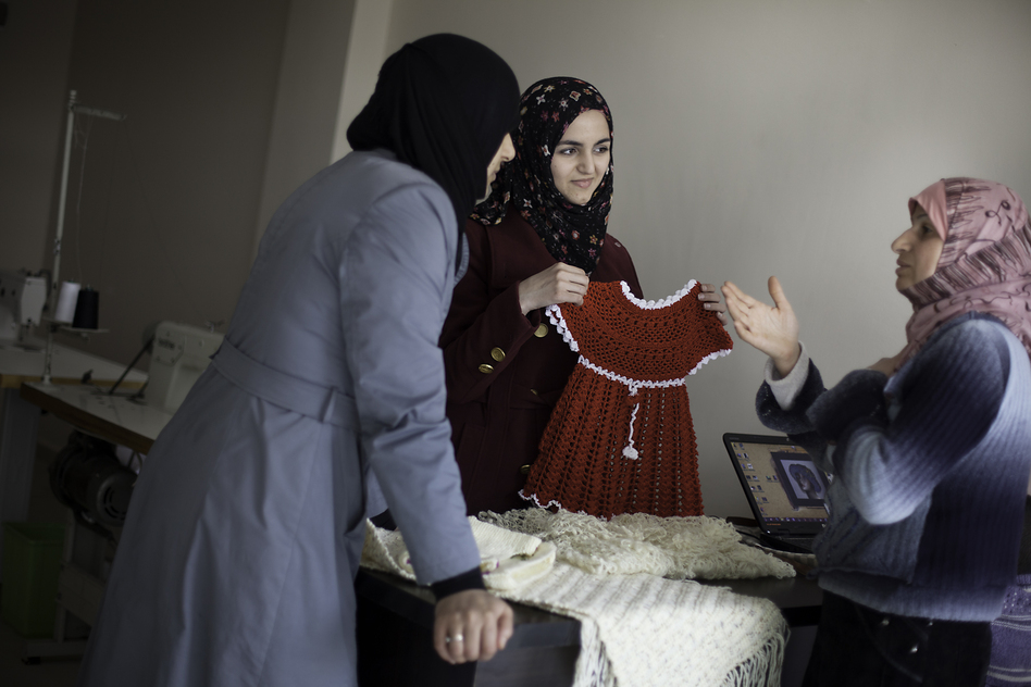 Marwa Sayd Essa (center), a Syrian architecture student, works with refugee women at a handicrafts program in southern Turkey. (Jodi Hilton for NPR)