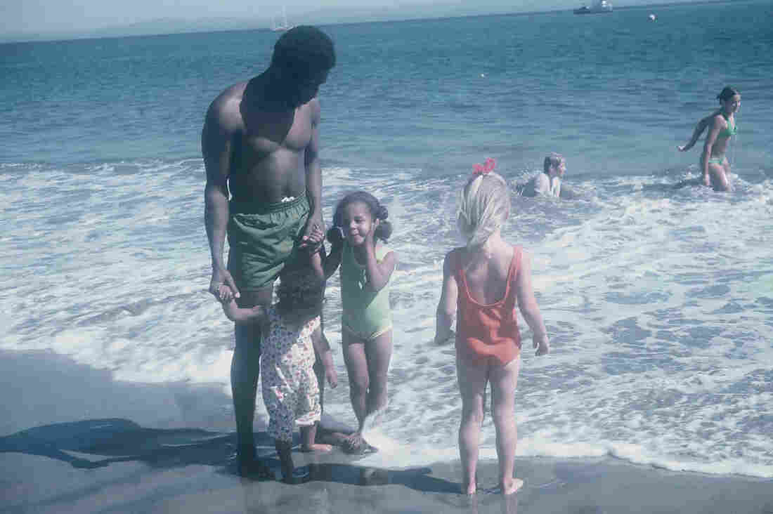 Akpem's father and sisters on the beach in California with cousins.