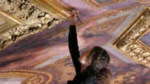 Restorer Nicoletta Rinaldi works on the ceiling of the Hall of Mirrors at the Versailles Palace,  west of Paris, in 2007.