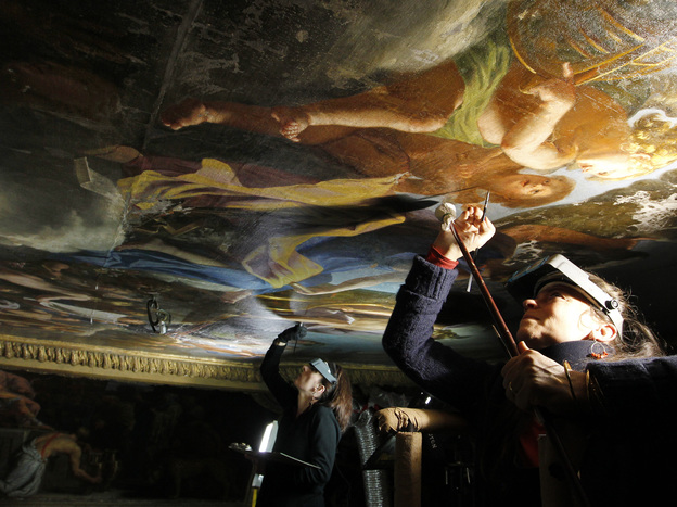 Restorers work on a painting in the Mercury drawing room in 2011. A lot of conservation takes place on Mondays, the only day the palace is closed.