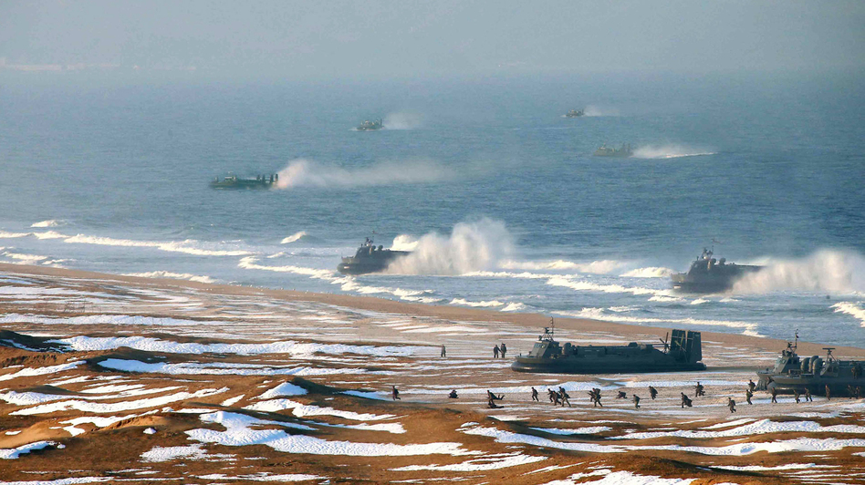 "North Korean ""landing and anti-landing drills"" are shown in a photo released Tuesday. (AFP/Getty Images)"
