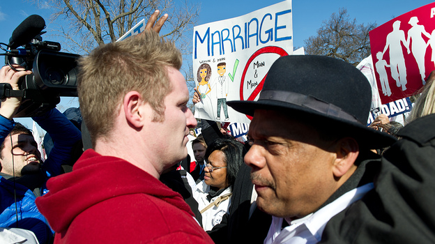 A member of the New York Hispanic Clergy Organization (right) is confronted by a pro-gay-marriage activist outside the Supreme Court on Tuesday. (AFP/Getty Images)