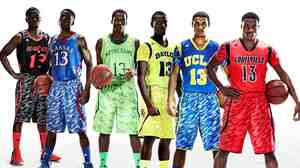 This photo illustration released by Adidas shows the uniforms for NCAA basketball teams (from left) University of Cincinnati, University of Kansas, University of Notre Dame, Baylor University, UCLA and the University of Louisville.