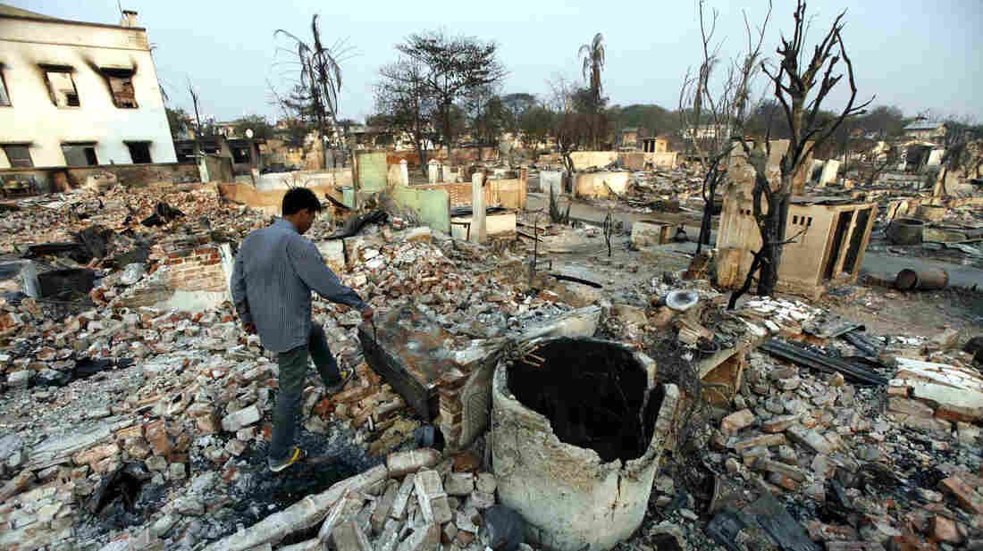 A man walks amid debris of buildings destroyed during ethnic unrest between Buddhists and Muslims in Meikhtila, about 340 miles north of Yangon, Myanmar, on Monday.