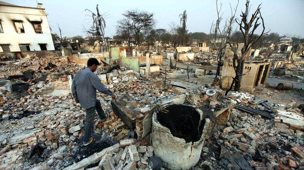 A man walks amid debris of buildings destroy