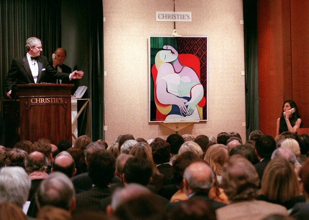 "Auctioneer Christopher Burge takes bids on Picasso's ""The D"