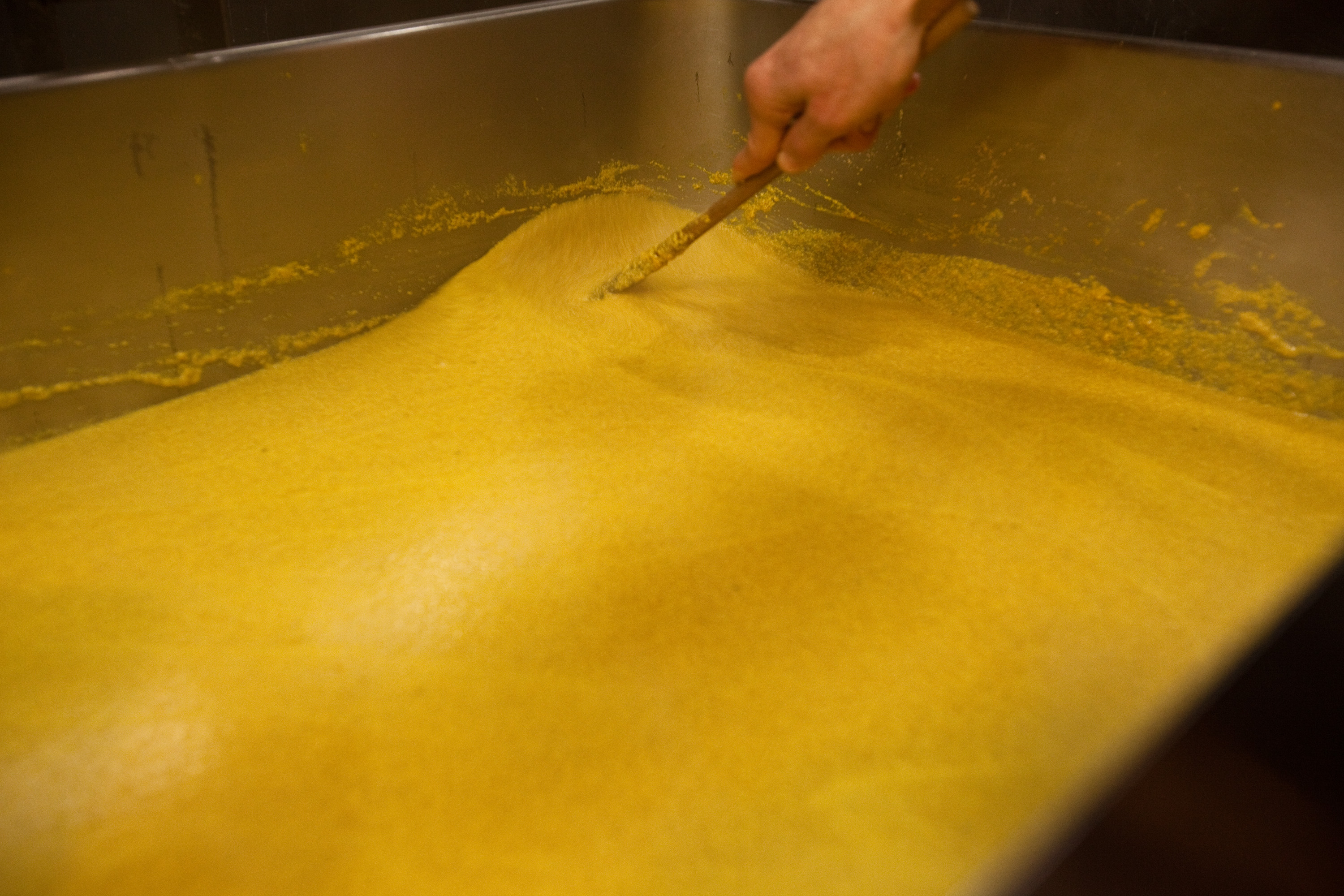 """There's this whole movement of people wanting to make everything from scratch,"" Koslow says. Restaurant workers prepare their own mustard by the gallon. A batch this size is about enough to last through the weekend crowds."