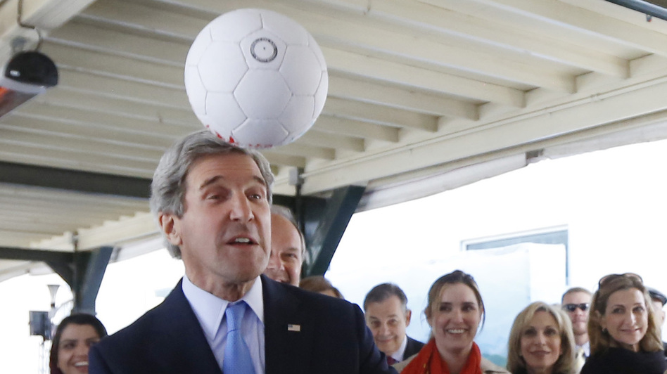 Secretary of State John Kerry using his head Tuesday in Kabul, where he met the captain of that nation's women's soccer team. (Reuters /Landov)