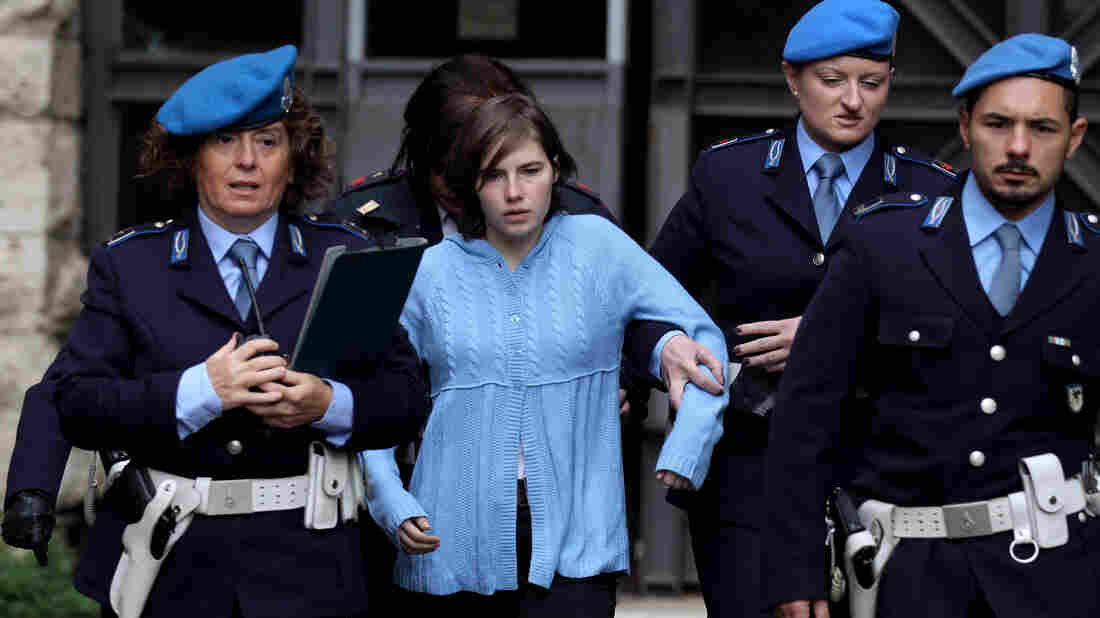 Amanda Knox is led away from an appeals court in Perugia, Italy, in November 2010. Her murder conviction in the death of a flatmate was ultimately overturned, but now, Italy's highest court has ruled she must be retried.