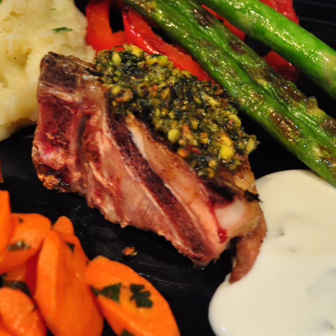 Pistachio, Mint And Spice Crusted Lamb Chops served with assorted vegetables