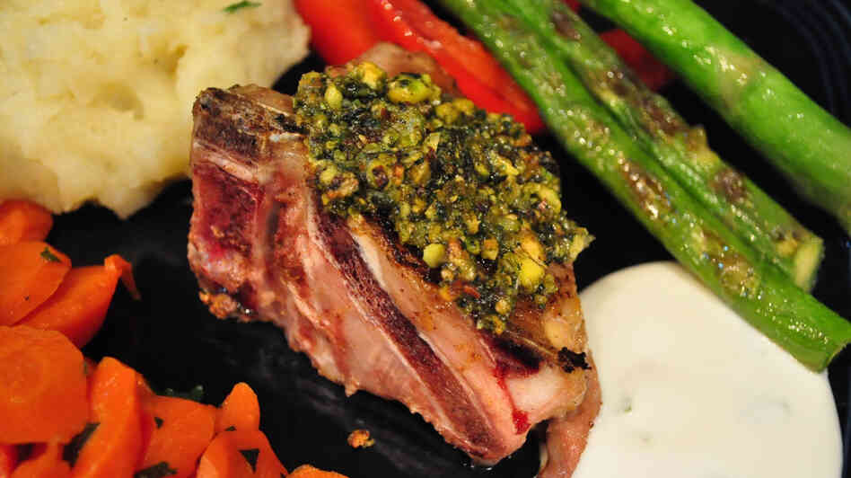 A lamb chop crusted with pistachio, mint and spices, served with assorted vegetables