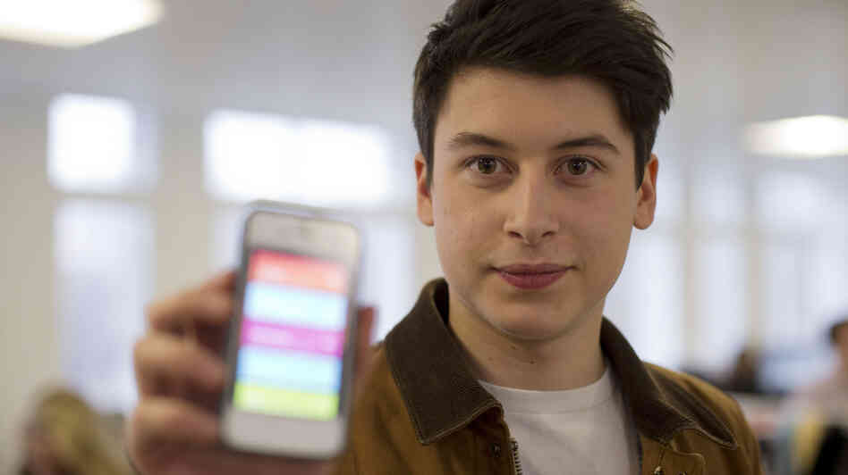 Nick d'Aloisio displays his mobile application Summly, which Yahoo recently purchased for a reported $30 million. But the Internet company is killing the app and integrating the algorithm that drives it into its own technology.