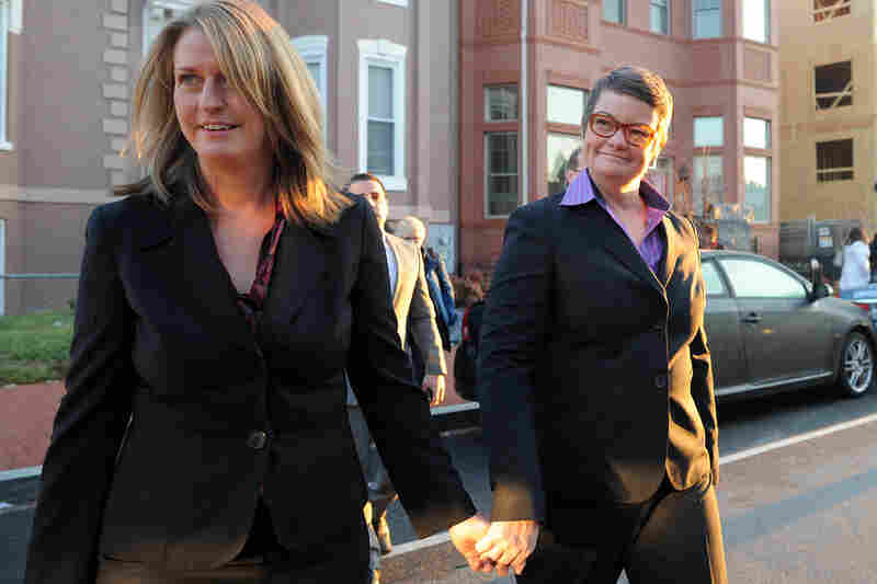Hollingsworth v. Perry plaintiffs Sandy Stier (left) and Kristin Perry head for the Supreme Court. They are challenging the constitutionality of Proposition 8, California's ban on same-sex marriage.