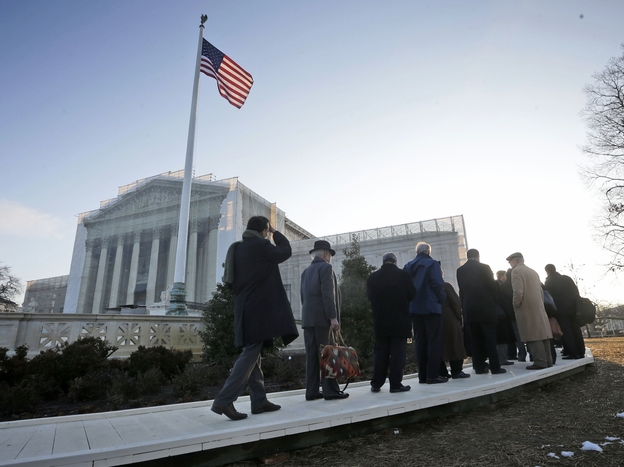 People file into the Supreme Court on Tuesday for the court's hearing on California's Proposition 8, a voter-approved ban on same-sex marriage.