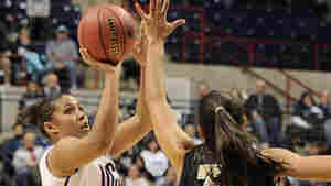 Connecticut's Kaleena Mosqueda-Lewis shoots over Vanderbilt's Elan Brown during the team's game Monday night in Storrs, Conn.