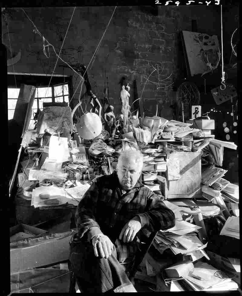 Sculptor Alexander Calder in his studio, 1957