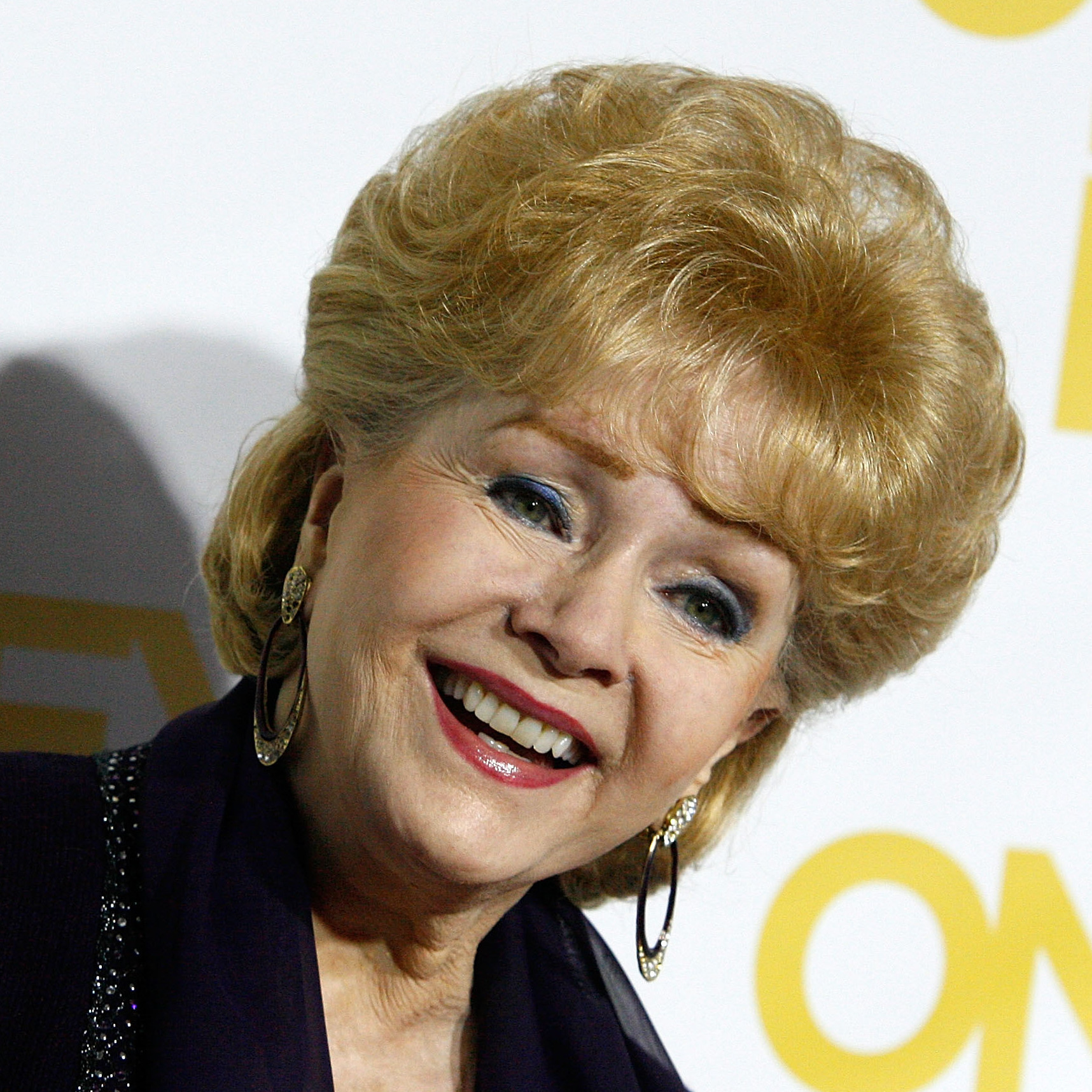 Debbie Reynolds, shown here in 2012, starred in Singin' In The Rain and The Unsinkable Molly Brown.