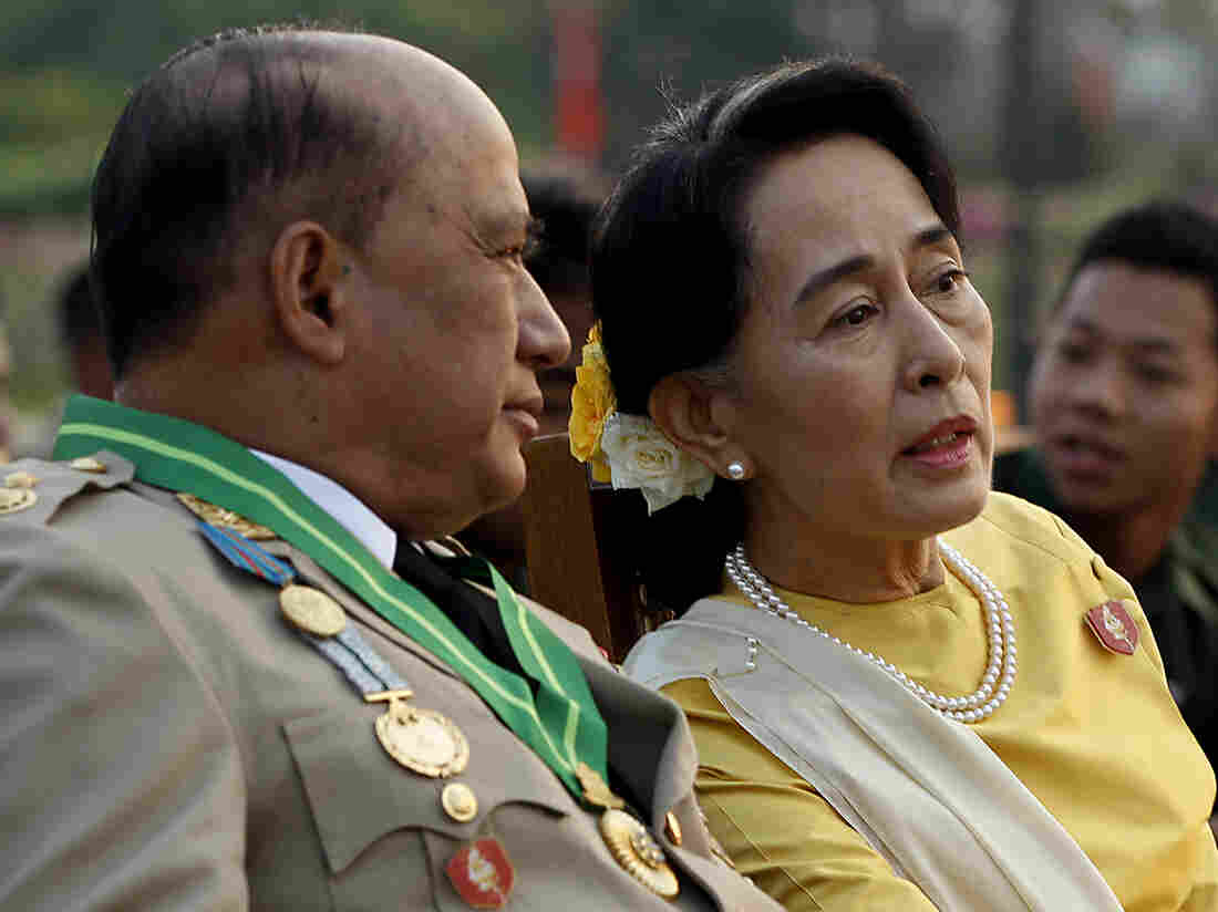 Opposition leader Aung San Suu Kyi (right) speaks with Maj. Gen. Zaw Win, deputy minister for border affairs, during a ceremony Wednesday marking Myanmar's 68th Armed Forces Day.