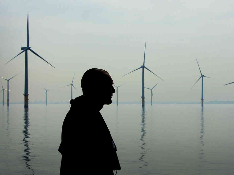 A maintenance worker looks out over an off-shore wind farm in Liverpool, England in 2008. Some people are concerned about the potential health effects of noise from wind turbines.