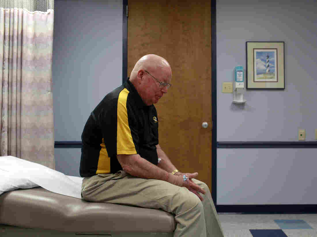 David Oliver sits quietly as he waits for the results of a scan at Ellis Fischel Cancer Center in Columbia, Mo., in 2012. The University of Missouri research professor was diagnosed with cancer in September 2011. He broke the news to colleagues via a video on the Internet.
