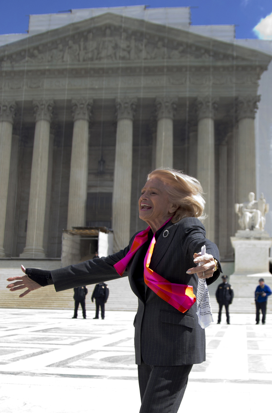 Plaintiff Edith Windsor, who challenged the federal Defense of Marriage Act, looks toward supporters in front of the Supreme Court on Wednesday. (AP)