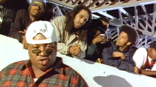 """A still from the video for E-40's 1993 song """"Practice Looking Hard,"""" in which rappers like The Coup's Boots Riley (second from right) and Tupac (not pictured) also appeared."""