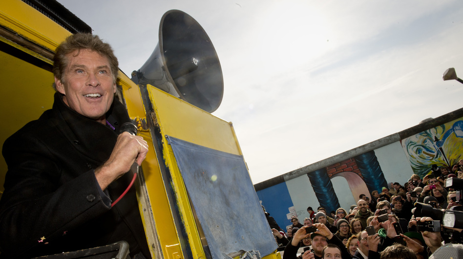American actor David Hasselhoff speaks to protesters next to a remnant of the Berlin Wall last week. Thousands of people turned out to oppose a plan to knock down one of the few remaining sections of the wall. A small part was removed Wednesday. (AFP/Getty Images)