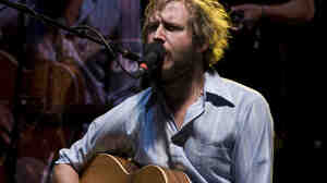 """Bon Iver's Justin Vernon in 2009, after the release of his mostly acoustic debut album, but before the group's second album, which includes the '80s-inspired saxophone jam """"Beth/Rest."""" (Yes, we noticed that his guitar is plugged in.)"""