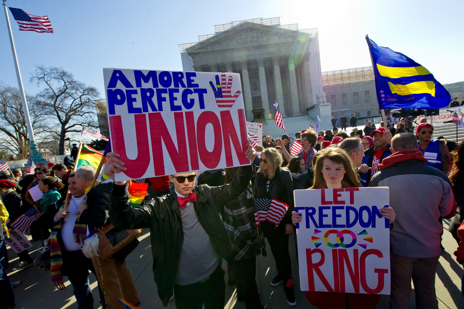 Same-sex marriage supporters march at the Supreme Court.