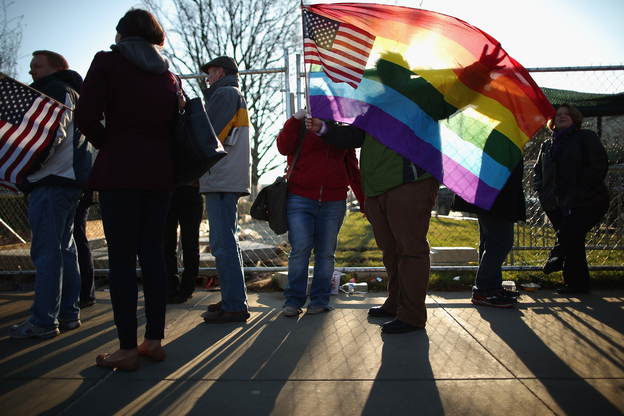Hundreds of people wait in line outside the Supreme Court, where oral arguments on the constitutionality of the Defense of Marriage Act will take place. (Getty Images)