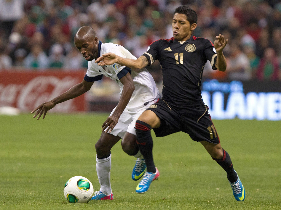 Javier Aquino (No. 11) of Mexico fights for the ball with DaMarcus Beasley of the U.S. during their team's match Tuesday in Mexico City. The game ended in a 0-0 tie.