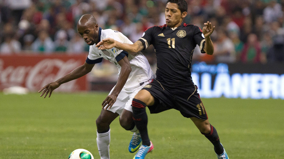 Javier Aquino (No. 11) of Mexico fights for the ball with DaMarcus Beasley of the U.S. during their team's match Tuesday in Mexico City. The game ended in a 0-0 tie. (Getty Images)