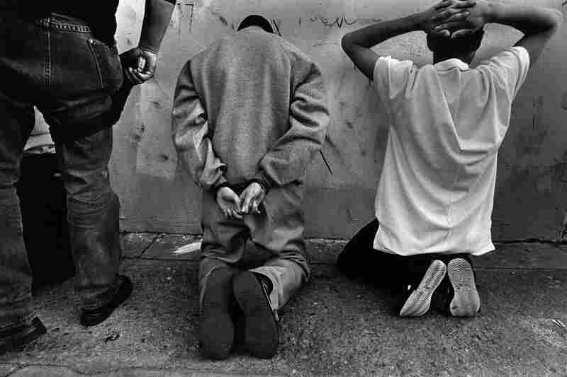 Suspected of being involved with gangs, these immigrant youth are targeted for deportation by agents with the Violent Gang Task Force, Westside, Los Angeles, 1994.