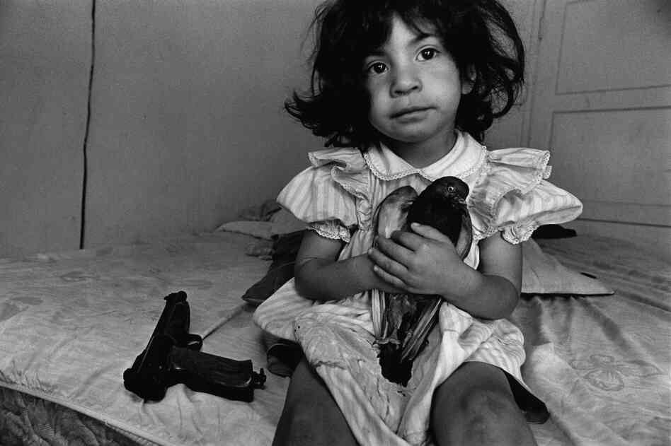 "Three-year-old ""Esperanza"" named her pet pigeon after her wheelchair-bound teenage uncle in Watts, Los Angeles. He was shot by a rival gang member in a drive-by shooting, 1994."