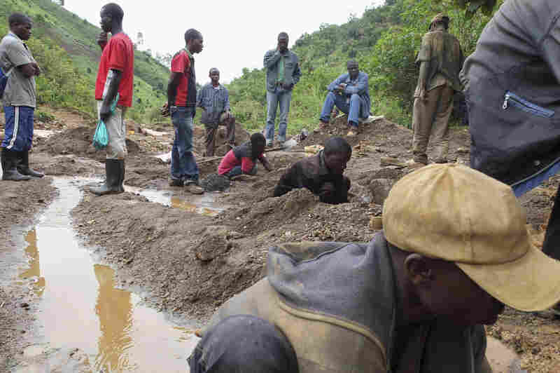Miners work in a tin mine near the small town of Nyabibwe, in the eastern Congo, in October.