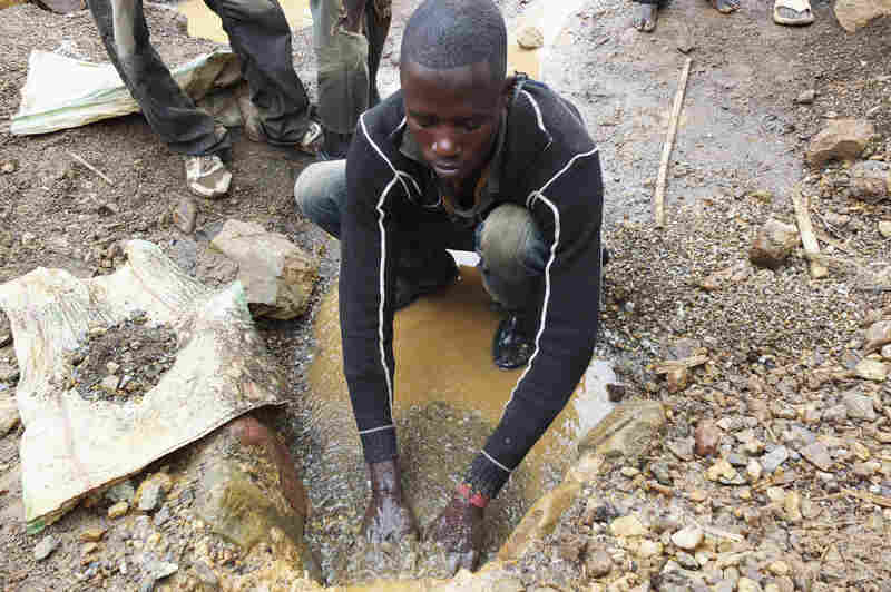 A miner works in a tin mine near Nyabibwe.