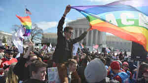 Same-sex marriage supporters demonstrate in front of the Supreme Court on Wednesday in Washington, D.C.