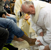 Pope Francis washes the feet of a prisoner at the Casal Del Marmo Youth Detention Centre during the mass of the Lord's Supper on Thursday in Rome.