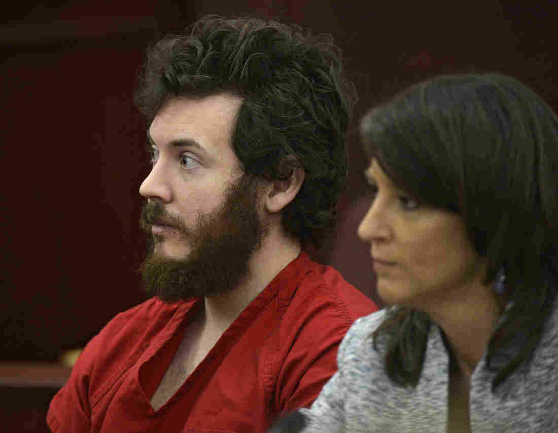 James Holmes, left, and defense attorney Tamara Brady appear in district court in Centennial, Colo. for his arraignment.