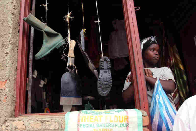 A woman sells mining supplies from a stall in Nyabibwe.