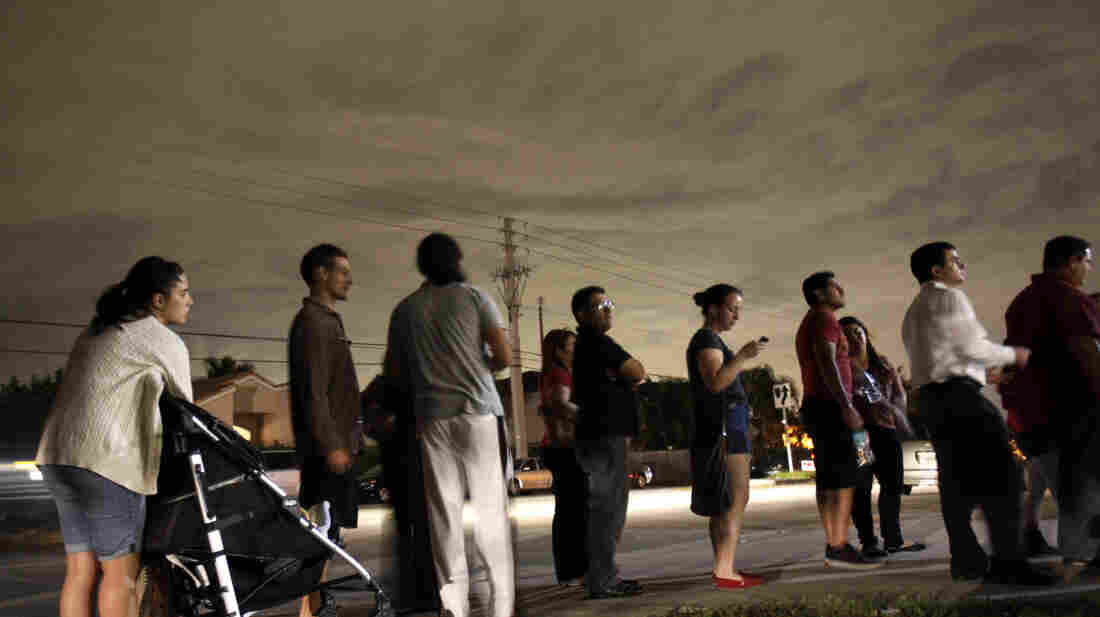 Voters line up into the night outside a Miami polling station, some waiting for hours to vote in the 2012 presidential election.