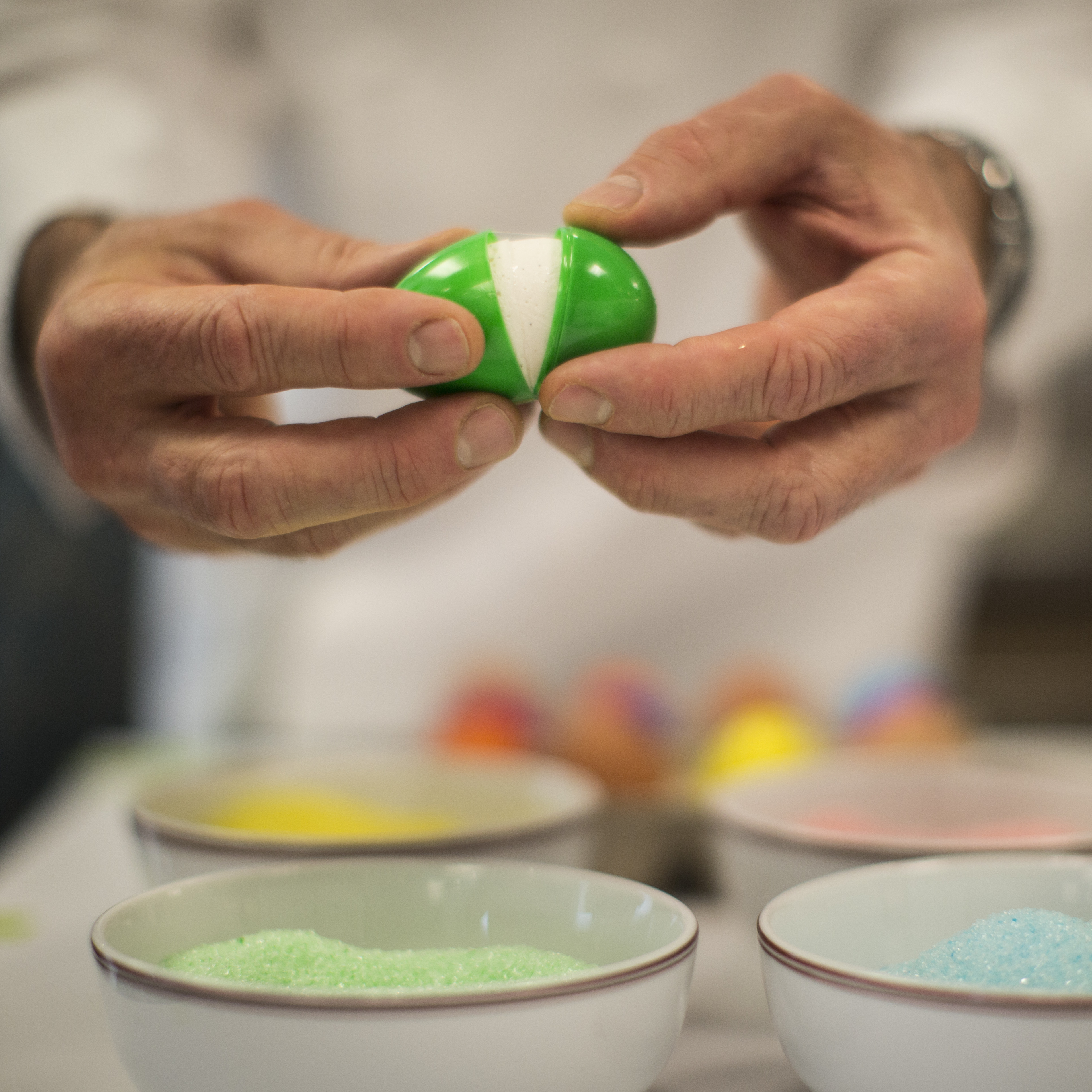 After the marshmallow has set, open the plastic shell and dip the egg in flavored and colored sugar, as Thomas Keller demonstrates here.